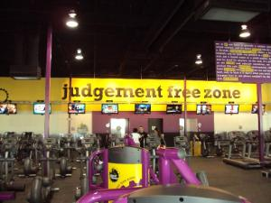 Photo of Planet Fitness logo and slogan in a physical Planet Fitness location